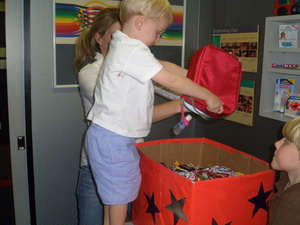 photo of children donating their halloween candy to one of our charities